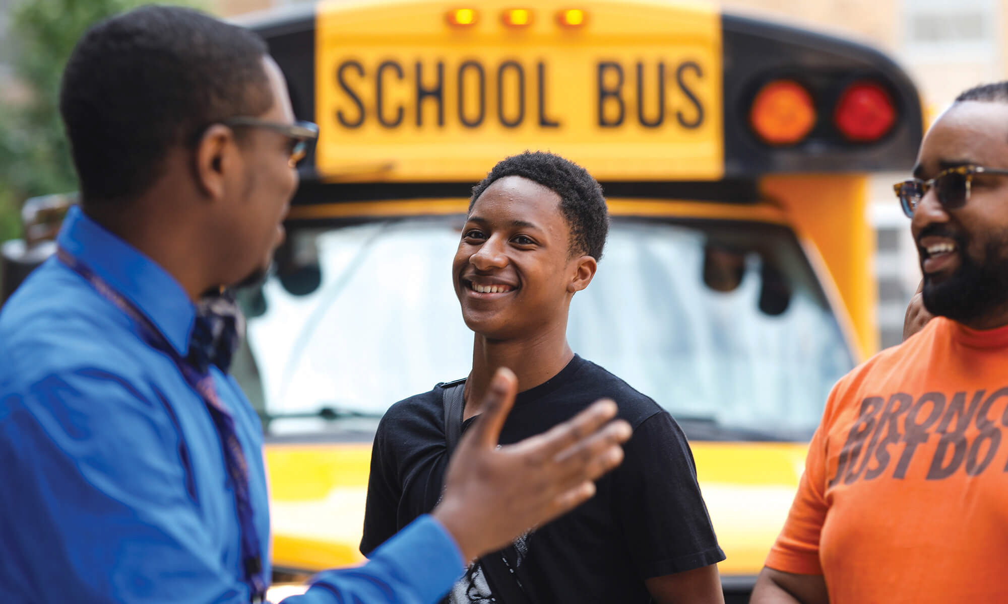 A Milwaukee-area youth and his parent arrives at the 2017 African American Male Initiative Summer Institute.