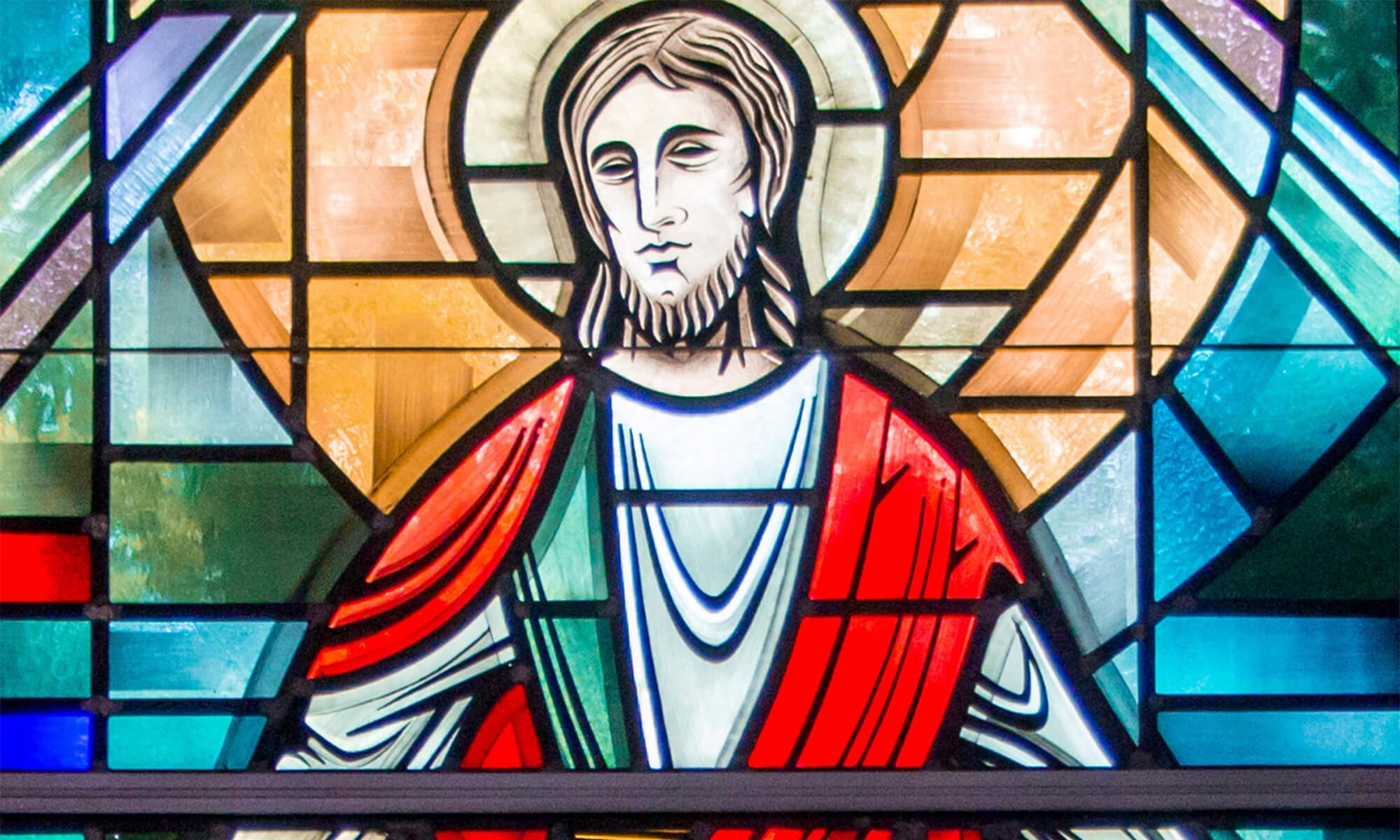 An image of the stained glass window in Concordia's Chapel of Christ Triumphant
