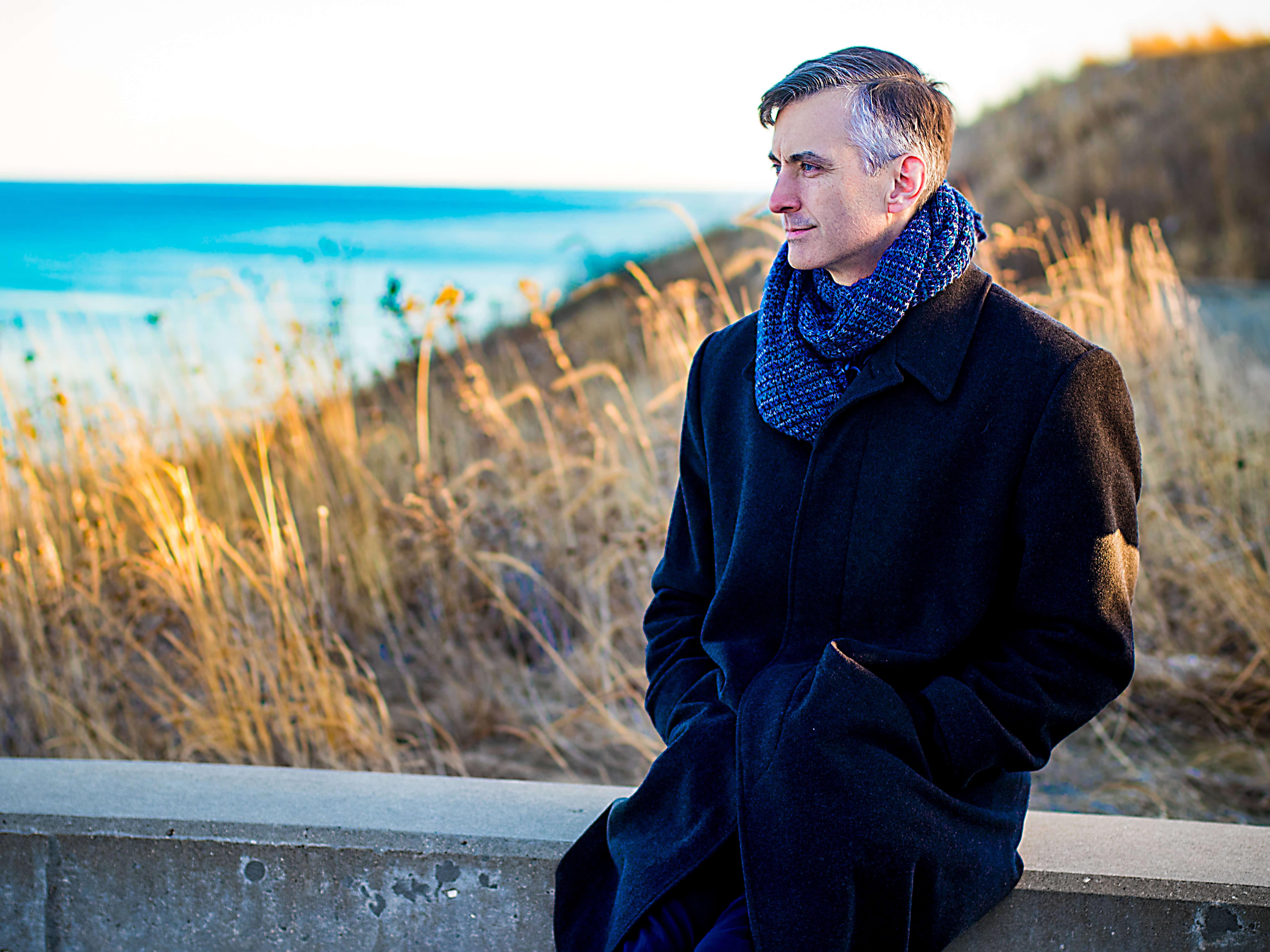 Bernard Bull overlooks Lake Michigan and contemplates Concordia's mission.