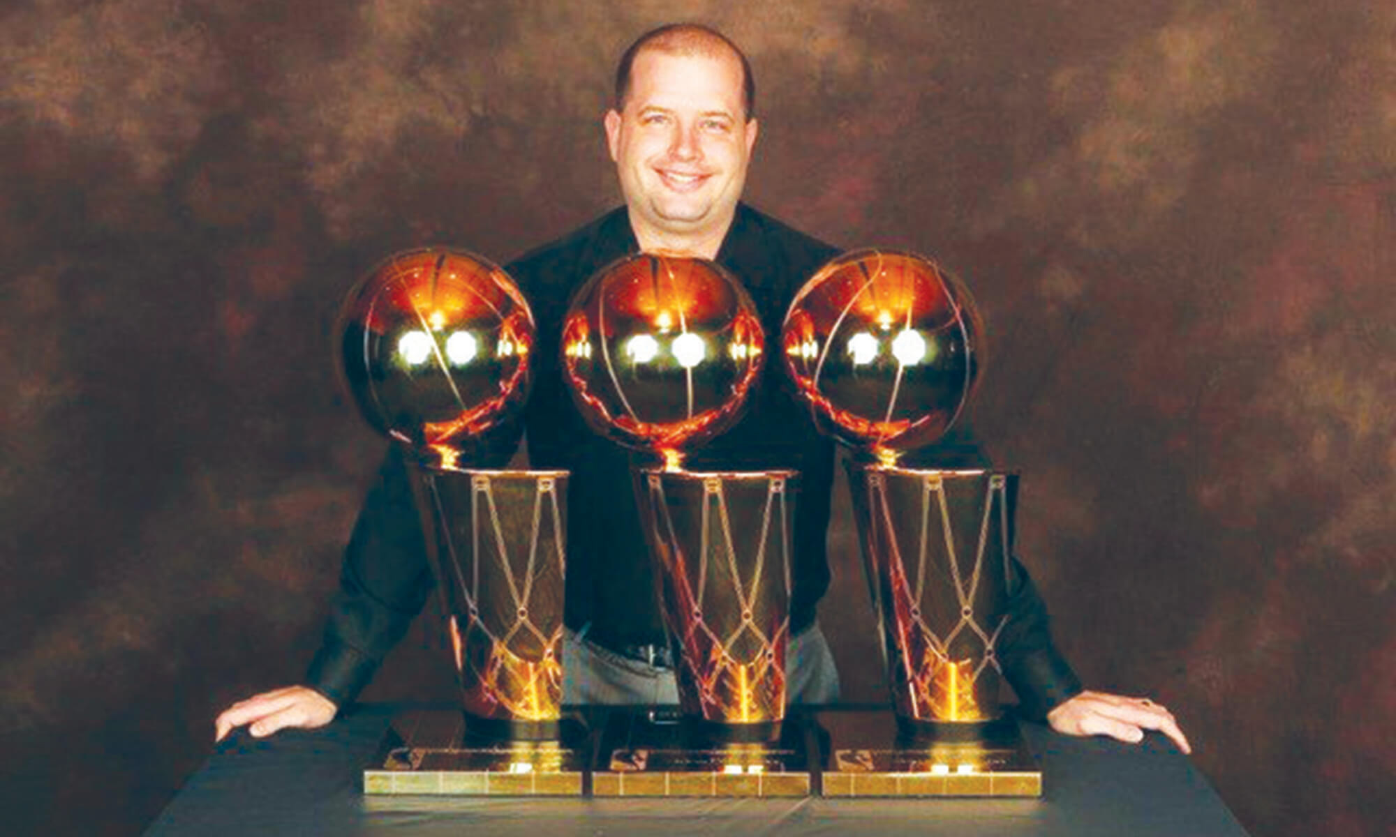 Dave Beyer and his championship tropheys