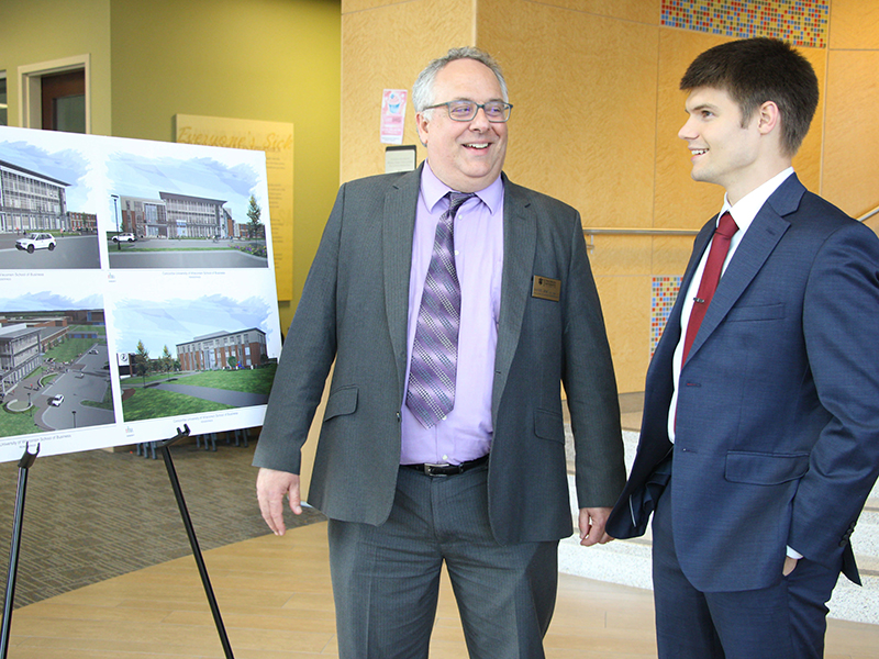 Batterman School of Business Dean Dr. Dan Sem talks with Student Government Association President Colter Dziekan after the groundbreaking ceremony.