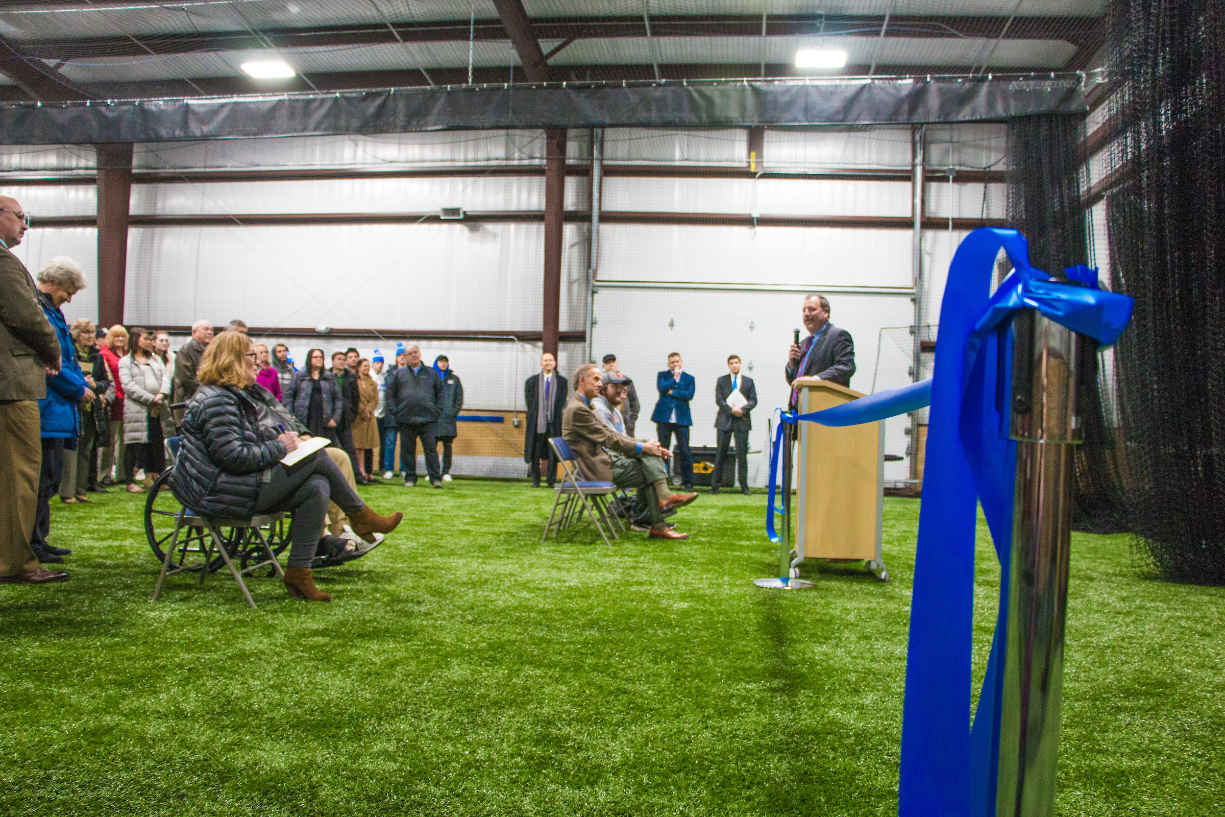 CUW Athletic Director Robert Barnhill addresses those who gathered for the Catalyst Sports Training Center open house.