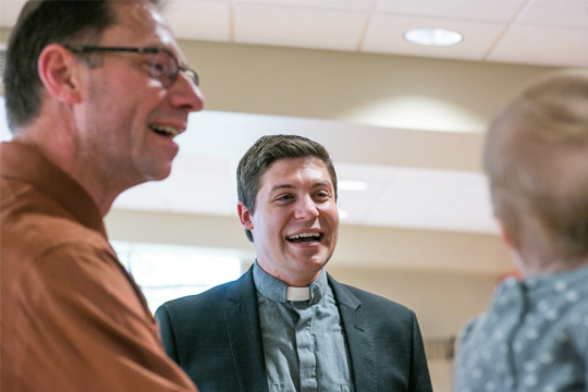Concordia's Associate Campus Pastor Doug Bender mingles with fellow colleagues on Monday.