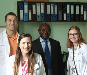 Jared Gillingham, Amanda Bartosik, and Taylor Poulsen with the clinical pharmacist of the Zambia oncology department.