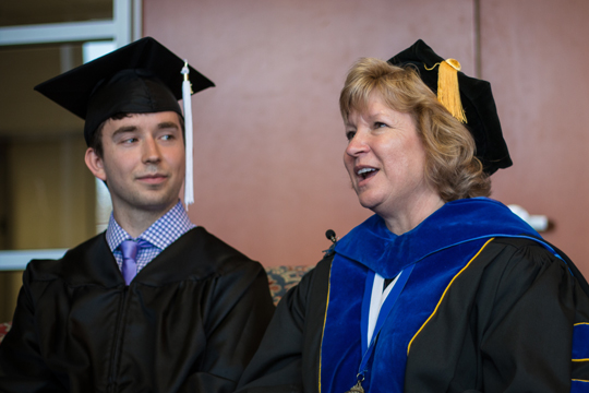 Following Concordia's commencement ceremonies on Saturday, May 13, Dr. Linda Samuel, right, expresses pride in her son's achievement in front of Fox6, CBS58 and WISN12 camera crews.