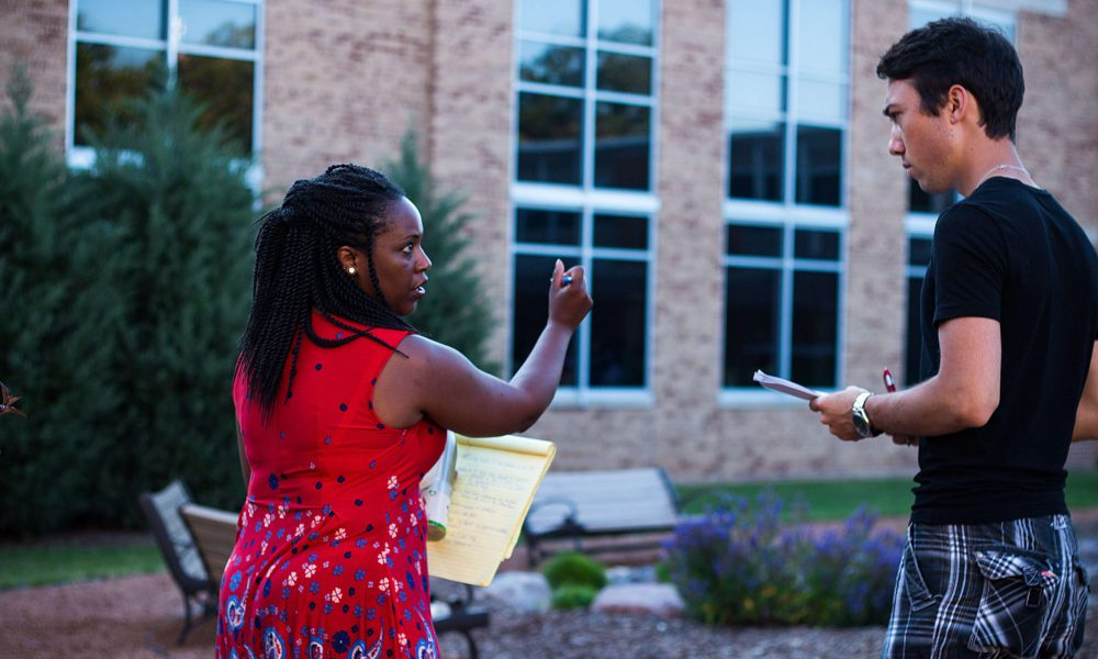 Assistant Professor Lori Woodall-Schaufler directs students during a rehearsal for an outdoor Concordia production.