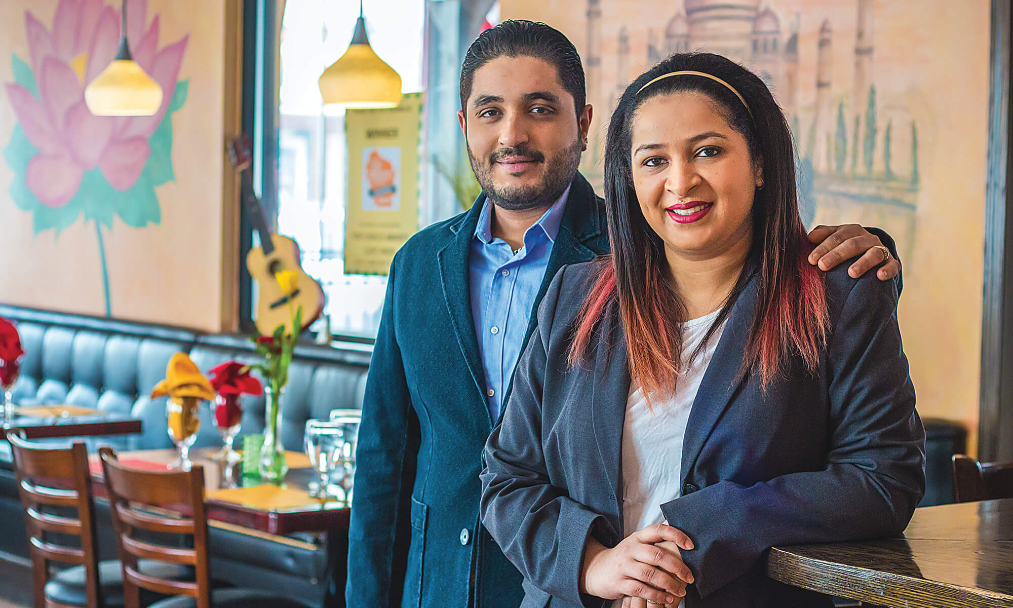 Manisha Dhillon (left) and Shitanshu Saini have earned their place at Café India. Restaurant owner Rakesh Rehan says he plans to have the 2017 CUW graduates on board for the long haul.
