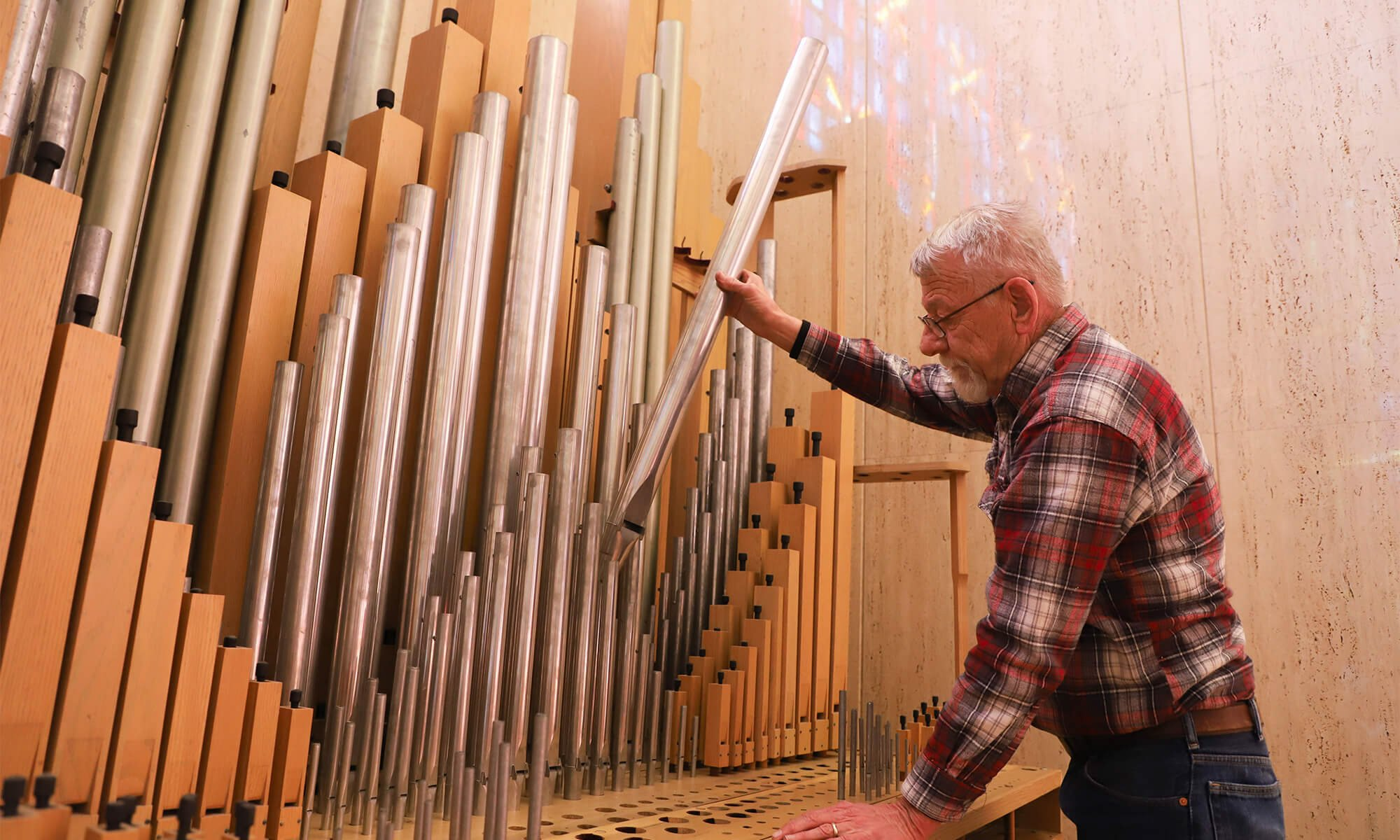 Stanton Peters assembles the new pipe organ in Concordia's Rogate Chapel.