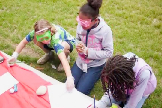 Children participating in a science experiment during a STEAM (Science, Technology, Engineering, Art, and Mathematics) camp.