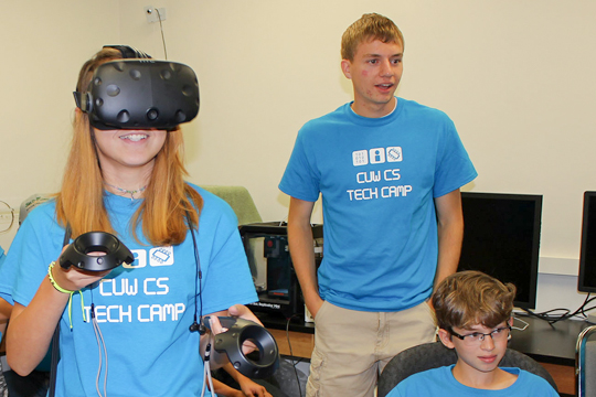 Kids experiment with HTC Vive virtual reality headset.
