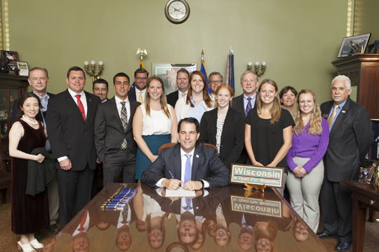 Representatives from Wisconsin's three pharmacy schools, including Concordia University Wisconsin, attended an Aug. 2 bill signing at the Wisconsin State Capitol.